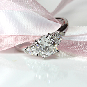 Cushion Cut Ring with Pear Shape Side Diamonds